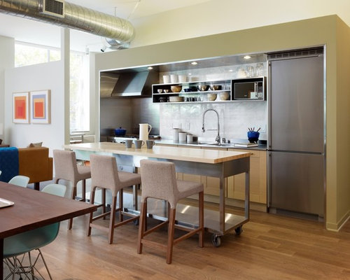 Minimalist Single Wall Open Concept Kitchen Photo In Los Angeles With Stainless  Steel Countertops,
