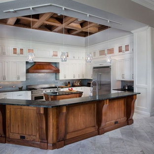 Inspiration for a large arts and crafts l-shaped open plan kitchen in Miami with shaker cabinets, white cabinets, soapstone benchtops, grey splashback, stainless steel appliances, multiple islands, subway tile splashback, marble floors and grey floor.