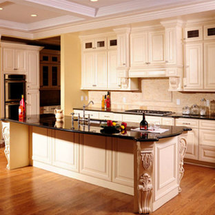 Kitchen pictures - Light wood floor kitchen photo in Sacramento with white cabinets