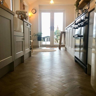 Galley kitchen in Sierra 9759 luxury vinyl planks in herringbone pattern