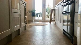 Galley kitchen in Sierra 9759 luxury vinyl planks in herringbone pattern