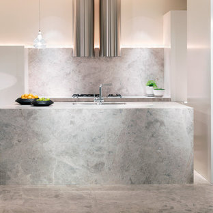 Inspiration for a contemporary galley eat-in kitchen in Melbourne with a drop-in sink, marble benchtops, stone slab splashback, stainless steel appliances, marble floors and with island.