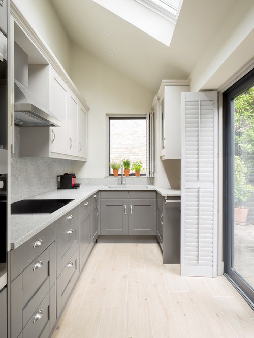 Small Classic U Shaped Kitchen In London With Beige Floors, A Submerged  Sink,