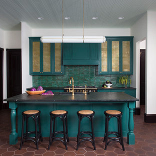 Design ideas for an eclectic eat-in kitchen in Austin with an undermount sink, green cabinets, green splashback, black appliances, with island and brown floor.