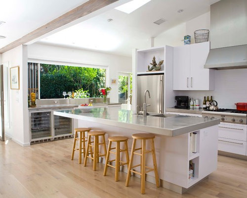 Contemporary Galley Open Concept Kitchen Idea In Los Angeles With  Flat Panel Cabinets, White