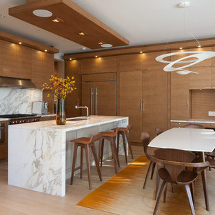 Design ideas for a large midcentury l-shaped eat-in kitchen in Toronto with light hardwood floors, a single-bowl sink, flat-panel cabinets, medium wood cabinets, marble benchtops, grey splashback, stone slab splashback, stainless steel appliances and with island.