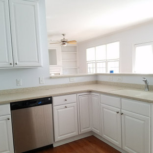 Photo of a mid-sized traditional u-shaped kitchen pantry in Raleigh with an integrated sink, beaded inset cabinets, white cabinets, limestone benchtops, multi-coloured splashback, limestone splashback, stainless steel appliances, dark hardwood floors, no island and multi-coloured benchtop.