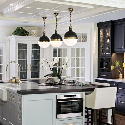 Kitchen - traditional dark wood floor and brown floor kitchen idea in Boston with a farmhouse sink, shaker cabinets, black cabinets and an island