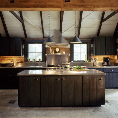 Large mountain style single-wall open concept kitchen photo in Austin with a drop-in sink, stainless steel countertops, blue cabinets, metallic backsplash, metal backsplash and an island
