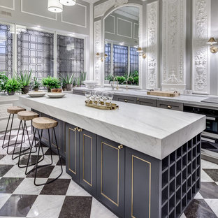 Traditional single-wall kitchen in London with a submerged sink, recessed-panel cabinets, grey cabinets, marble worktops, integrated appliances, marble flooring and an island.