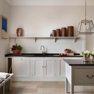 Inspiration for a transitional kitchen in London with an undermount sink, recessed-panel cabinets, with island and grey cabinets.