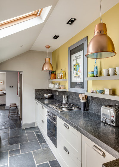 Eclectic Kitchen by Arq-A Interiors Limited