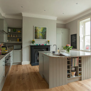 Design ideas for a classic kitchen/diner in Other with a submerged sink, shaker cabinets, grey cabinets, granite worktops, stone slab splashback, stainless steel appliances, medium hardwood flooring and an island.