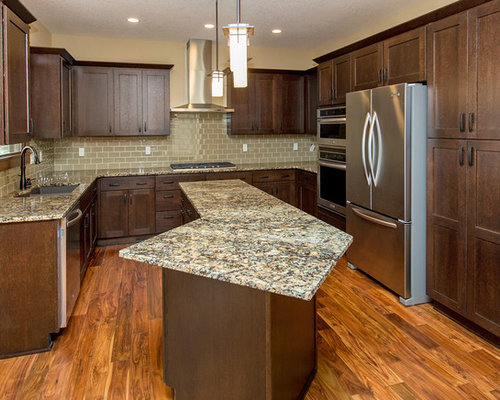 Example Of A Classic Kitchen Design In Other With Granite Countertops