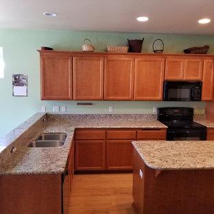 Kitchen - kitchen idea in Seattle with an undermount sink, granite countertops and stone slab backsplash