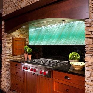 他の地域の大きいアジアンスタイルのおしゃれなキッチン (落し込みパネル扉のキャビネット、淡色木目調キャビネット、青いキッチンパネル、シルバーの調理設備の、セラミックタイルの床、御影石カウンター、セラミックタイルのキッチンパネル、茶色い床) の写真