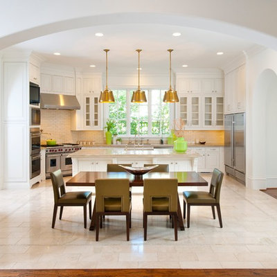 Tuscan eat-in kitchen photo in Dallas with glass-front cabinets, white cabinets and stainless steel appliances