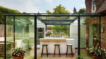 Glass box extension on thatched cottage