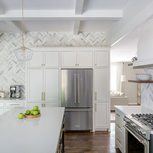 Large transitional eat-in kitchen ideas - Inspiration for a large transitional u-shaped dark wood floor and brown floor eat-in kitchen remodel in Raleigh with an undermount sink, shaker cabinets, white cabinets, quartzite countertops, gray backsplash, marble backsplash, stainless steel appliances, an island and white countertops