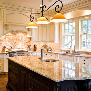 Traditional kitchen ideas - Example of a classic kitchen design in Charleston with stainless steel appliances