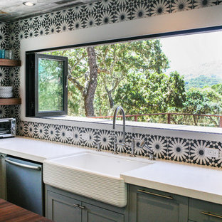 Transitional kitchen ideas - Example of a transitional kitchen design in San Francisco with a farmhouse sink, open cabinets, dark wood cabinets and multicolored backsplash