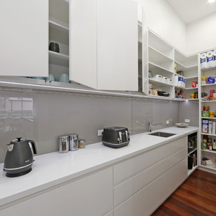 Photo of a contemporary single-wall kitchen pantry in Melbourne with an undermount sink, flat-panel cabinets, white cabinets and grey splashback.
