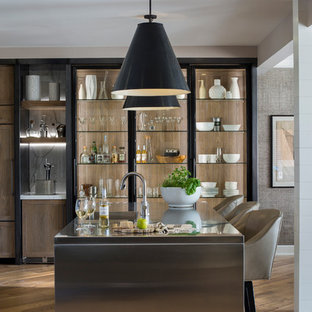 This is an example of a mid-sized transitional kitchen in Other with stainless steel benchtops, with island, an integrated sink, medium hardwood floors and open cabinets.