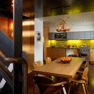 This is an example of a small contemporary single-wall eat-in kitchen in San Francisco with a drop-in sink, flat-panel cabinets, light wood cabinets, concrete benchtops, yellow splashback, ceramic splashback, stainless steel appliances and dark hardwood floors.