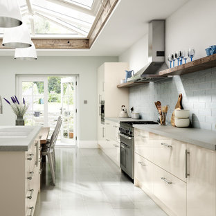 Inspiration for a large traditional single-wall eat-in kitchen in Other with a double-bowl sink, flat-panel cabinets, beige cabinets, laminate benchtops, blue splashback, subway tile splashback, coloured appliances, porcelain floors, with island and white floor.