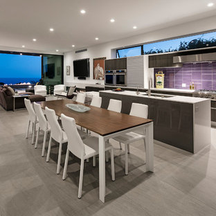 Photo of a mid-sized contemporary u-shaped open plan kitchen in Los Angeles with an undermount sink, flat-panel cabinets, dark wood cabinets, quartz benchtops, pink splashback, mosaic tile splashback, stainless steel appliances, porcelain floors, with island and grey floor.