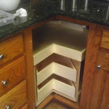 Glide-Around Corner Cabinet Solution