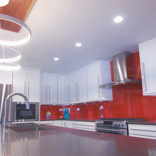 Mid-sized modern eat-in kitchen appliance - Example of a mid-sized minimalist l-shaped bamboo floor and gray floor eat-in kitchen design in Chicago with an undermount sink, flat-panel cabinets, white cabinets, quartzite countertops, red backsplash, glass sheet backsplash, stainless steel appliances and an island