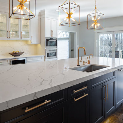 Kitchen - large transitional dark wood floor and brown floor kitchen idea in Other with an undermount sink, white cabinets, quartz countertops, white backsplash, stone slab backsplash, stainless steel appliances, an island, white countertops and recessed-panel cabinets
