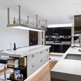 Kitchen - contemporary kitchen idea in Brisbane with stainless steel appliances