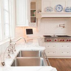 Transitional Kitchen by Corinthian Fine Homes