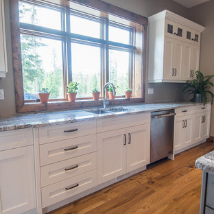 Large farmhouse eat-in kitchen ideas - Example of a large farmhouse u-shaped medium tone wood floor eat-in kitchen design in Vancouver with an undermount sink, shaker cabinets, white cabinets, granite countertops, stainless steel appliances and an island