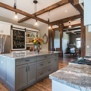 Large farmhouse eat-in kitchen ideas - Eat-in kitchen - large country u-shaped medium tone wood floor eat-in kitchen idea in Vancouver with white cabinets, granite countertops, stainless steel appliances, an island, an undermount sink and shaker cabinets