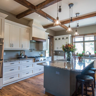 Large farmhouse eat-in kitchen designs - Eat-in kitchen - large cottage u-shaped medium tone wood floor eat-in kitchen idea in Vancouver with white cabinets, granite countertops, an island, an undermount sink, shaker cabinets and stainless steel appliances