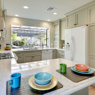 Traditional kitchen photos - Kitchen - traditional u-shaped kitchen idea in Sacramento with a double-bowl sink, shaker cabinets, green cabinets, quartz countertops, glass tile backsplash, white appliances and gray backsplash