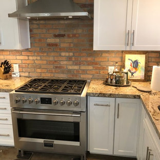 Inspiration for an eat-in kitchen remodel in Other with an undermount sink, granite countertops, stone tile backsplash, stainless steel appliances and multicolored countertops