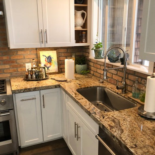 Eat-in kitchen photo in Other with an undermount sink, granite countertops, stone tile backsplash, stainless steel appliances and multicolored countertops