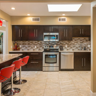 Contemporary kitchen in Tampa with an undermount sink, flat-panel cabinets, dark wood cabinets, brown splashback, matchstick tile splashback, stainless steel appliances, with island, beige floor and brown benchtop.