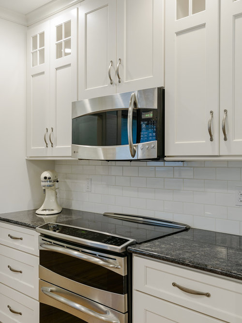 Minimalist Kitchen Photo In Other With White Cabinets And Granite  Countertops