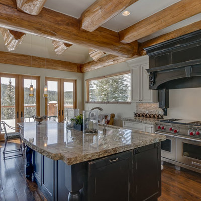 Mid-sized mountain style l-shaped dark wood floor and brown floor eat-in kitchen photo in Other with an undermount sink, recessed-panel cabinets, black cabinets, stainless steel appliances, an island and granite countertops