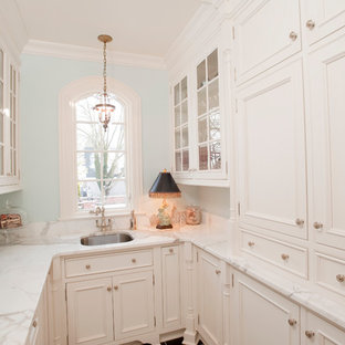 Inspiration for a small traditional galley kitchen pantry in Indianapolis with an undermount sink, white cabinets, marble benchtops, ceramic floors, black floor and white benchtop.