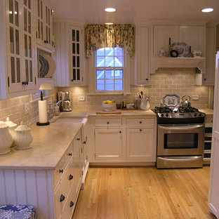 Design ideas for a traditional kitchen in DC Metro with limestone benchtops and panelled appliances.