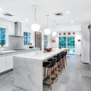 Large modern eat-in kitchen pictures - Inspiration for a large modern gray floor eat-in kitchen remodel in New York with flat-panel cabinets, white cabinets, quartz countertops, gray backsplash, an island, gray countertops and an undermount sink