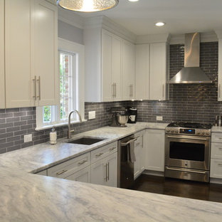 Eat-in kitchen - modern dark wood floor eat-in kitchen idea in Richmond with white cabinets, granite countertops, gray backsplash, subway tile backsplash, stainless steel appliances and no island