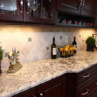 Example of a trendy kitchen design in DC Metro with glass-front cabinets, granite countertops and dark wood cabinets