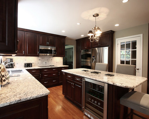 Trendy Kitchen Photo In DC Metro With Raised Panel Cabinets, Stainless  Steel Appliances And